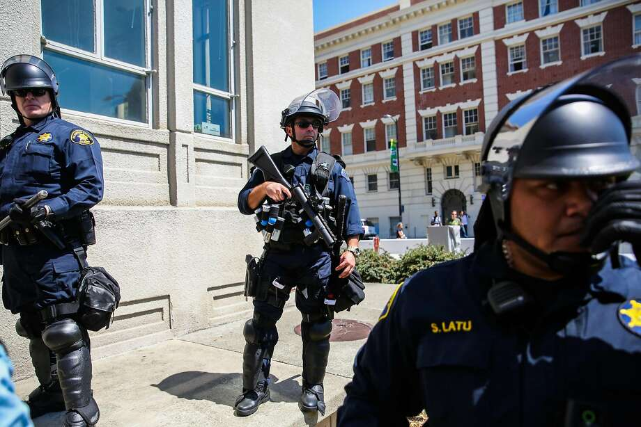 Police officers stand by during a protest at Martin Luther King Jr. Civic Center Park in Berkeley, Calif., on Sunday, August 27th, 2017. Photo: Gabrielle Lurie, The Chronicle