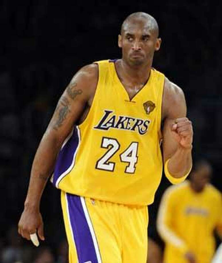 3316d75d45f AP Los Angeles Lakers guard Kobe Bryant gestures during the second half of  Game 7 of