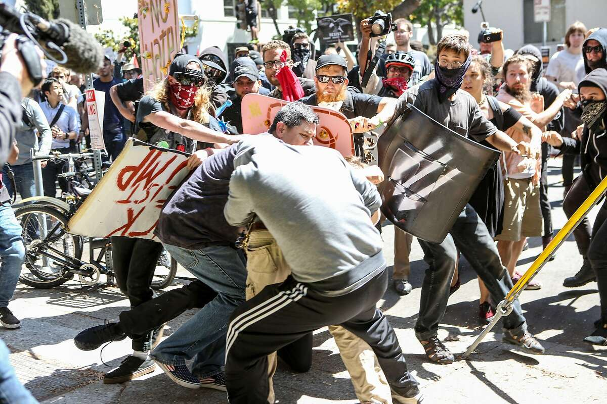 TOPSHOT - No-To-Marxism rally members and counter protesters clash on August 27, 2017 at Martin Luther King Park Jr. Civic Center Park in Berkeley, California. / AFP PHOTO / Amy OsborneAMY OSBORNE/AFP/Getty Images