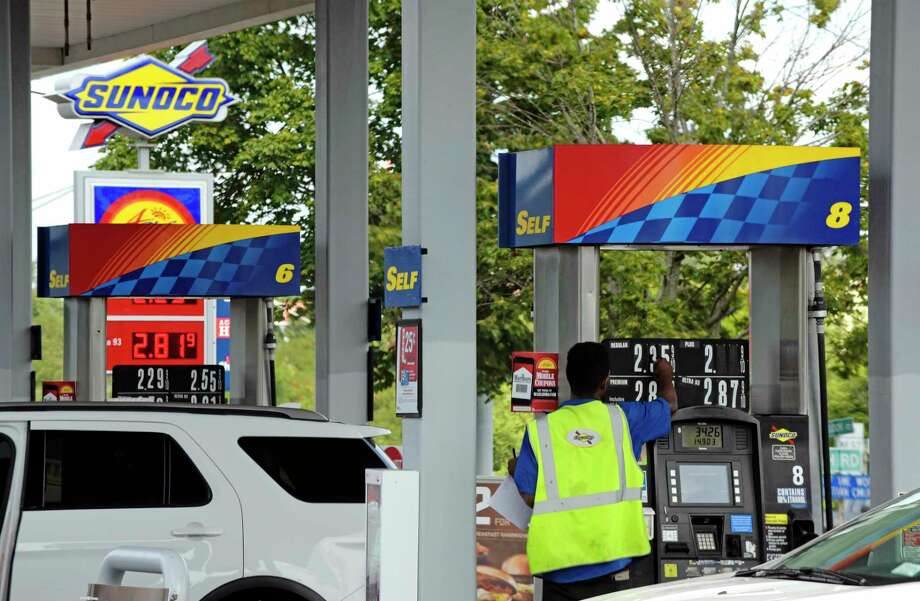 A worker changes the price board above the gas pumps at a Sunoco gas station on Monday, Aug. 28, 2017, in Latham, N.Y.  (Paul Buckowski / Times Union) Photo: PAUL BUCKOWSKI / 20041402A