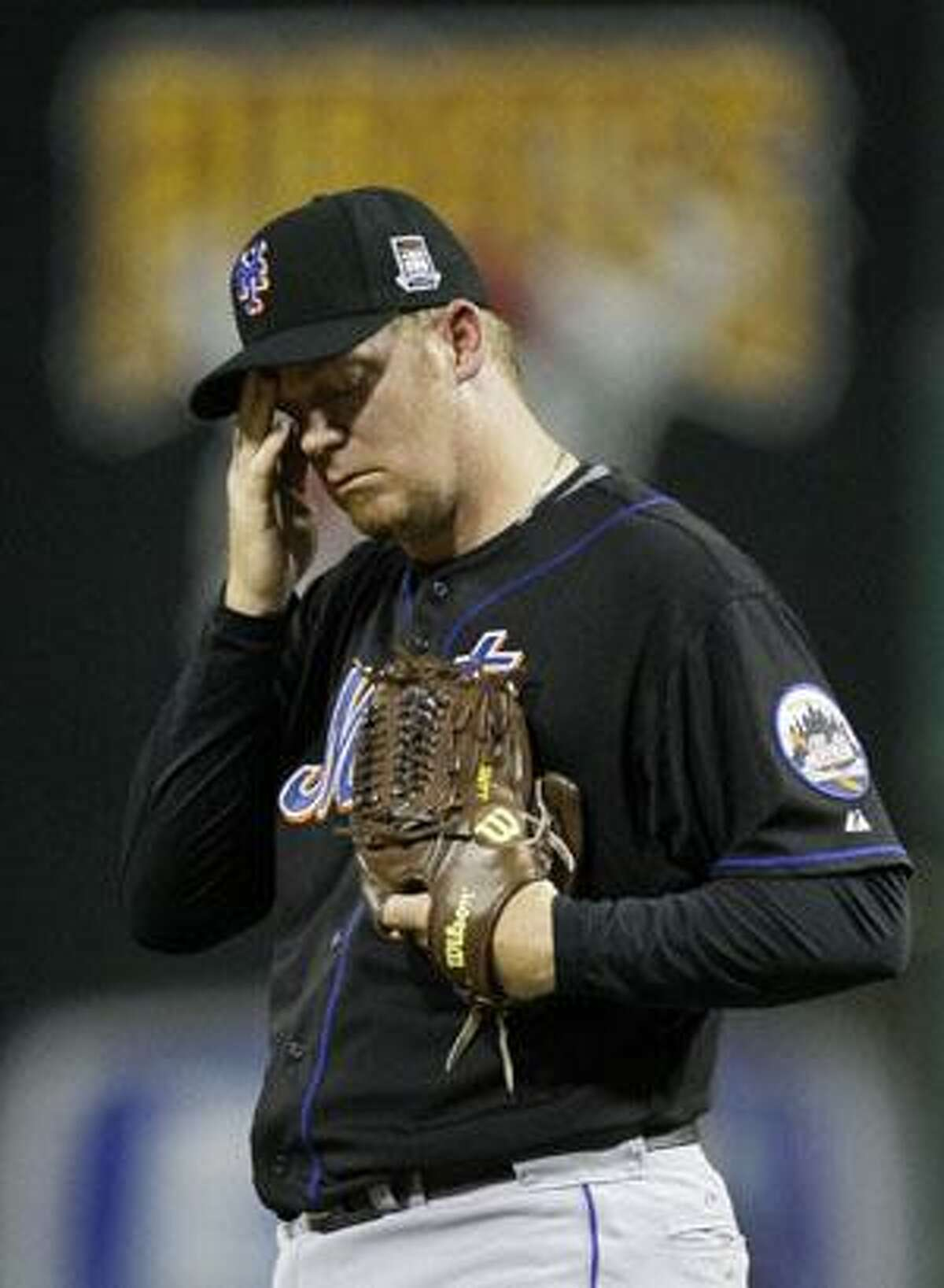 New York Mets pitcher J.J. Putz pauses on the mound during the five-run eighth inning against the Pittsburgh Pirates Monday in Pittsburgh. The Pirates won 8-5. (AP Photo/Gene J. Puskar)
