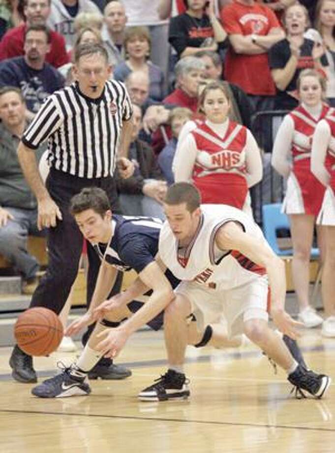 Shepaug's Henry Pendergast, left, and Northwestern's Chris Laudati fight for a loose ball during the Berkshire League tournament championship game Friday at Litchfield High School.
