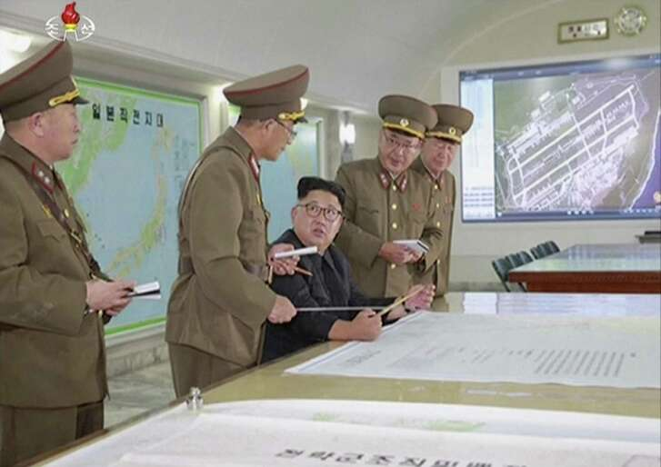 North Korean leader Kim Jong Un receives a briefing in Pyongyang on Aug. 14. Foreign policy failures over the past several decades have given North Korea more time for weapons development.