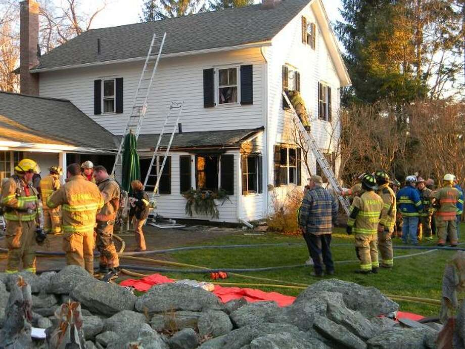 A crew of firefighters from Sharon, Kent, Cornwall, Warren, Amenia, N.Y. and Wassaic, N.Y. responded to the fire call at 33 Lucas Road in Sharon on Monday afternoon.