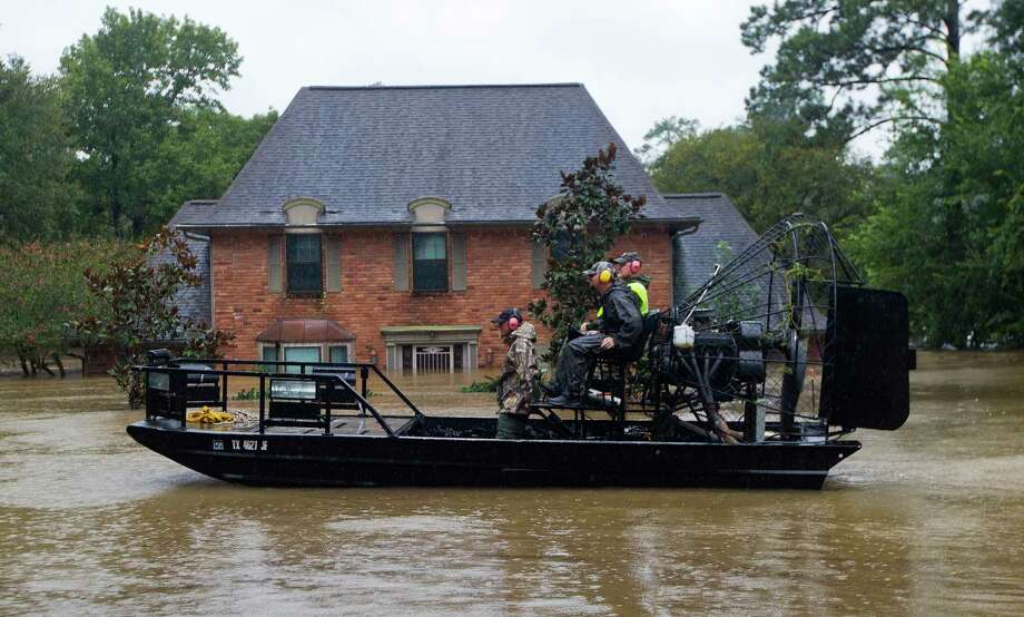 Rescuers with an airboat make their way through River Plantation, Monday, Aug. 28, 2017, in Conroe. Photo: Jason Fochtman, Staff Photographer / © 2017 Houston Chronicle