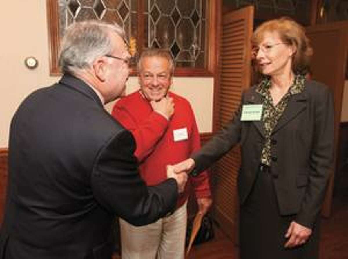 SONJA ZINKE/Register CitizenNorthwest Conservation District Board of Directors member Celeste Echlin meets newly elected Winsted Selectman George Closson and newly elected Torrington treasurer Art Mattiello at the Northwest Conservation District meeting Tuesday night at Marino's restaurant in Torrington. Purchase a glossy print of this photo and more at www.registercitizen.com