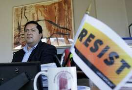 Berkeley Mayor Jesse Arreguin poses for photos in his office while being interviewed in Berkeley, Calif., Monday, Aug. 28, 2017. An anti-haterallyon Sunday was disrupted when scores of anarchists wearing black clothing and masks stormed the demonstration in Berkeley and attacked several supporters of President Donald Trump. But police were able to head off any wider violence. (AP Photo/Jeff Chiu)