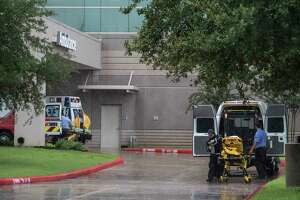 Emergency personnel line up outside the ambulance bay at Memorial Hermann Sugar Land as they work to evacuate the hospital Monday, Aug. 28, 2017, in Sugar Land.
