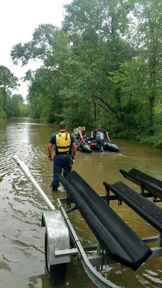 Water rescue on Loop Road. The Beaumont Police Department estimates officers have made 50 water rescues.Photo: Beaumont Police Department. Photo: BE