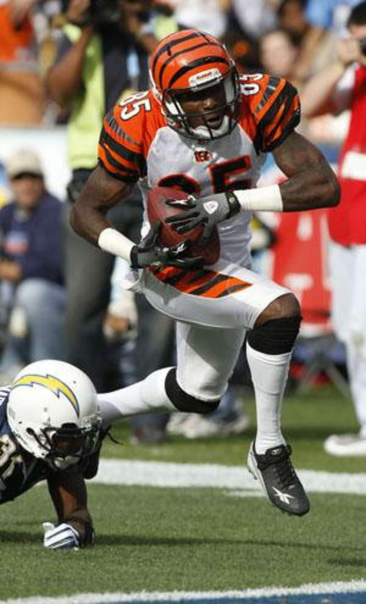 Cincinnati Bengals wide receiver Chad Ochocinco breaks away from San Diego Chargers cornerback Antonio Cromartie for a 49-yard touchdown reception Dec. 20 in San Diego.