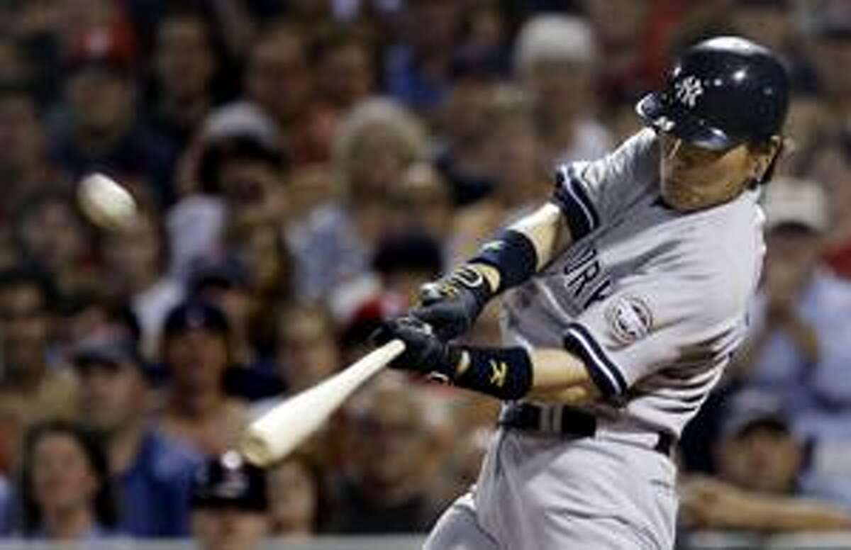 New York Yankees' Hideki Matsui hits a solo home run, his second homer of the game, off Boston Red Sox starter Josh Beckett during the eighth inning at Fenway Park in Boston, Sunday. (AP Photo/Charles Krupa)