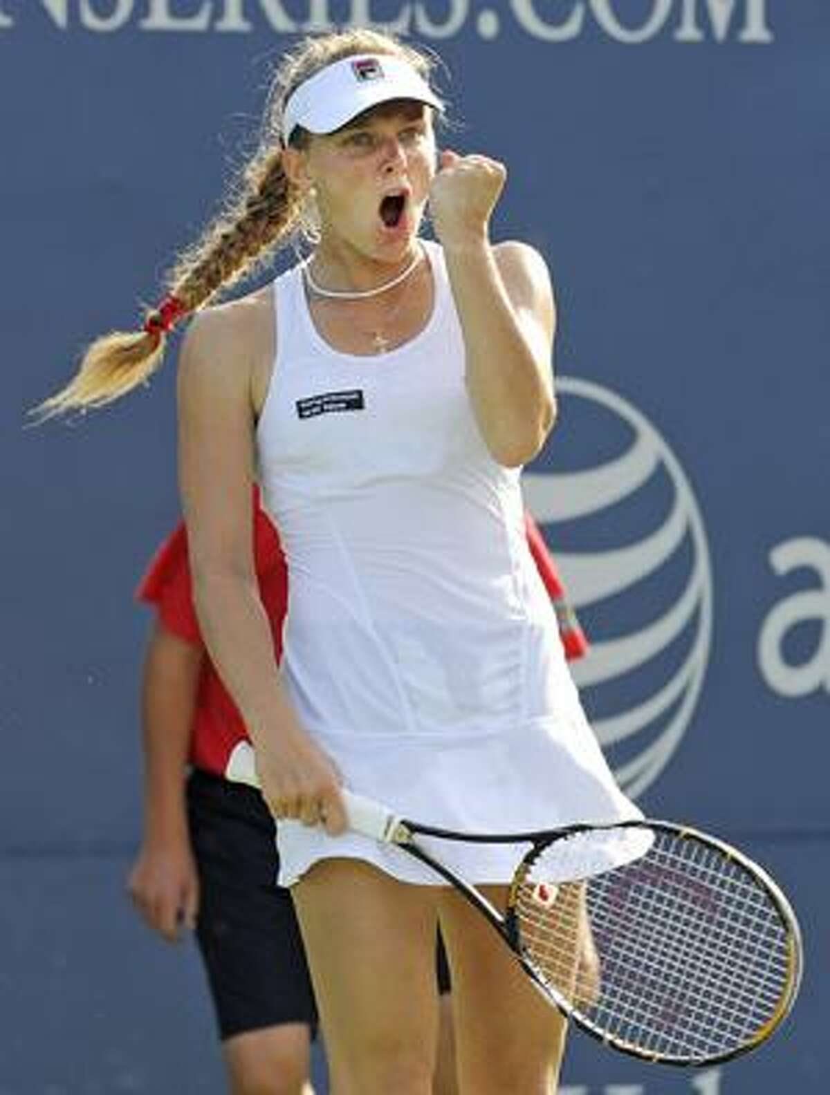 AP Anna Chakvetadze, of Russia, celebrates during the final game of her 0-6, 7-6(4), 6-4 upset victory over Nadia Petrova, also of Russia, in their first-round match at the Pilot Pen tennis tournament in New Haven on Sunday.