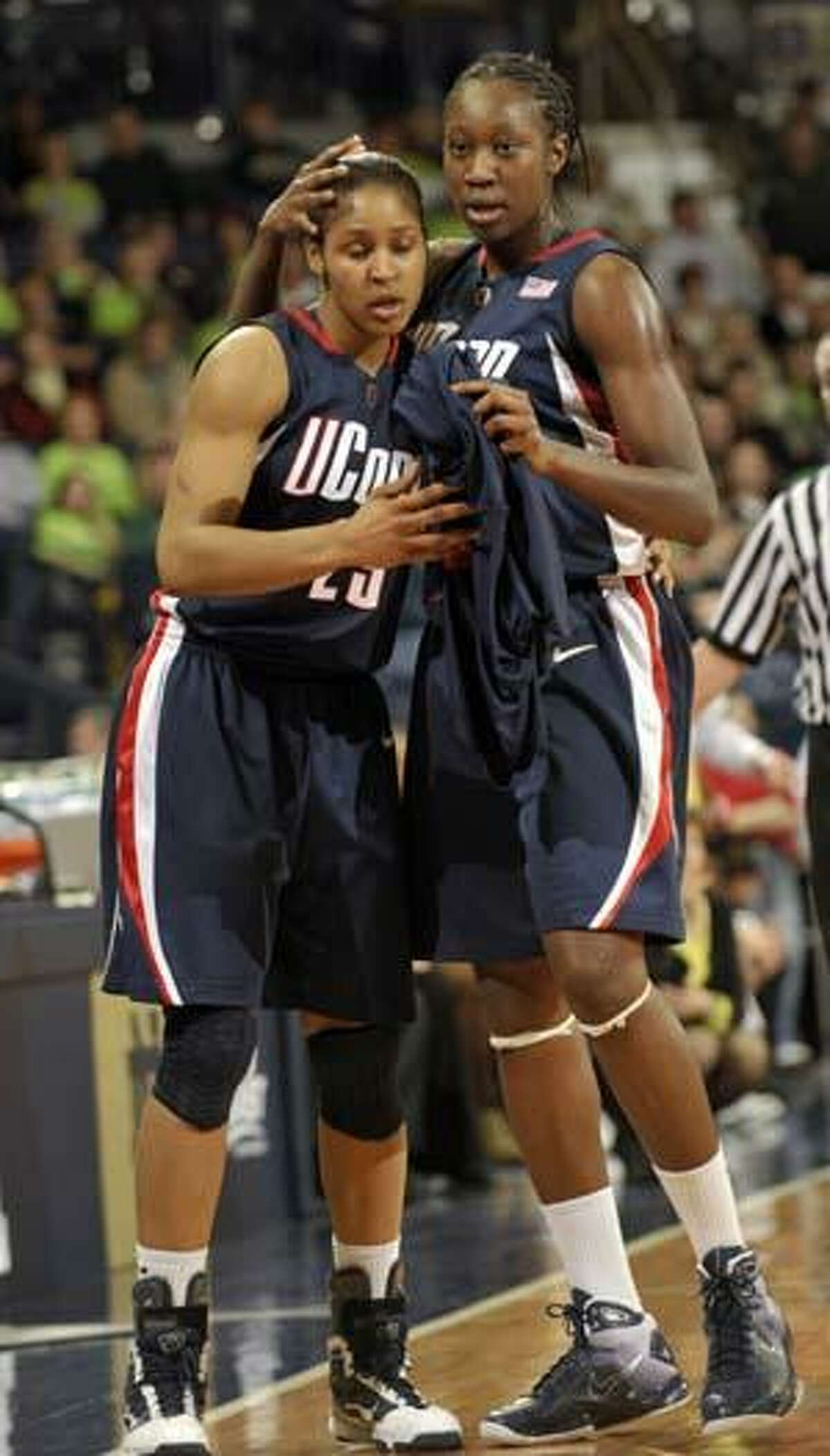 Connecticut center Tina Charles, right, pats her teammate forward Maya Moore on the head as they leave the court late in the second half of an NCAA college basketball game with Notre Dame Monday March 1, 2010, in South Bend, Ind. (AP Photo/Joe Raymond)