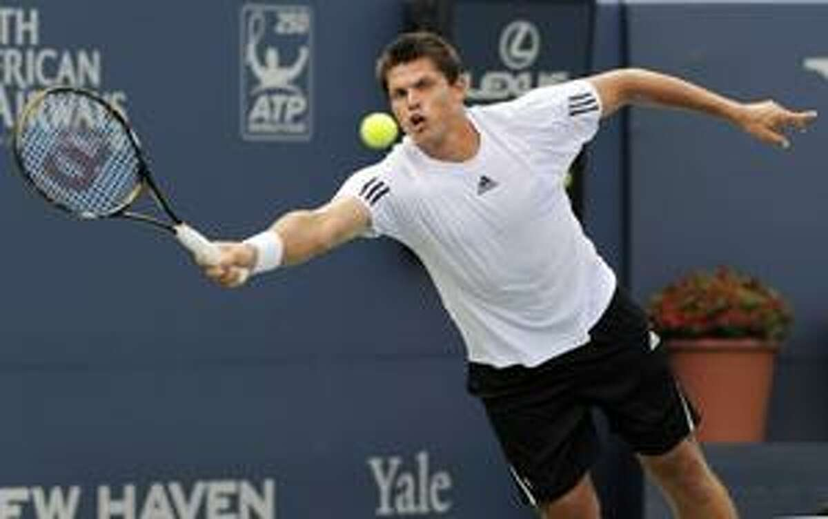 AP Taylor Dent stretches for a forehand during his 6-3, 6-4 victory over Ivan Ljubicic, of Croatia, during an opening-round match the Pilot Pen tennis tournament in New Haven on Sunday.