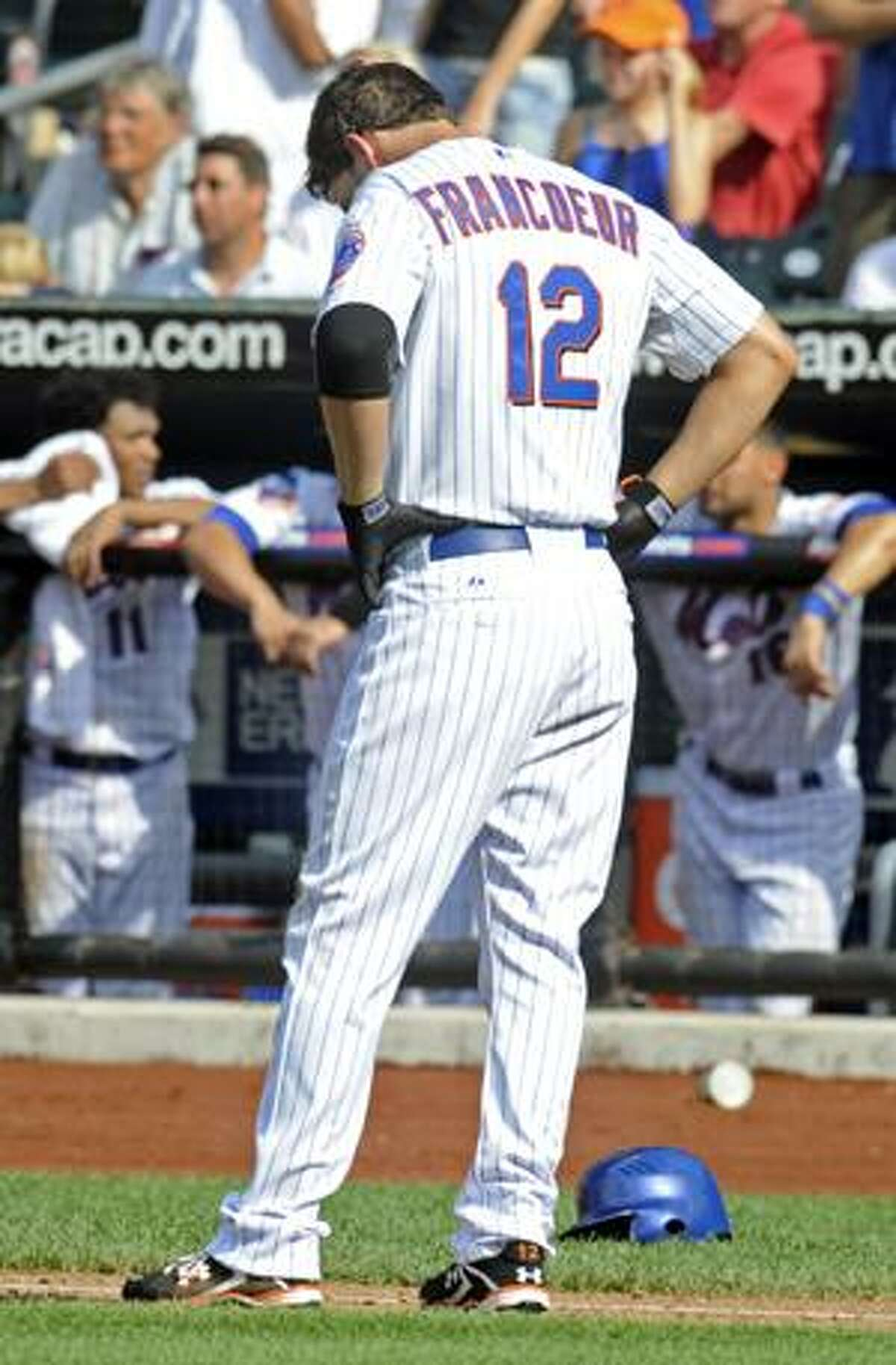 New York Mets' Jeff Francoeur reacts after hitting into an unassisted triple play to end their game with the Philadelphia Phillies in the bottom of the ninth inning at Citi Field in New York, Sunday. The Phillies won 9-7. (AP Photo/Henny Ray Abrams)