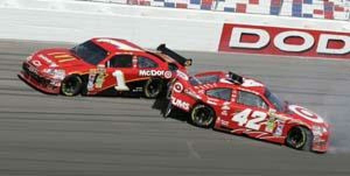 In this Sunday, Feb. 28, 2010, photo, Jamie McMurray drives past Juan Pablo Montoya, right, of Colombia, after the two collided during the NASCAR Sprint Cup Series auto race in Las Vegas. Two weeks after winning the Daytona 500, McMurray wrecked teammate Montoya on Sunday. (AP Photo/Las Vegas Review-Journal, Ched Whitney) ** LAS VEGAS SUN OUT **