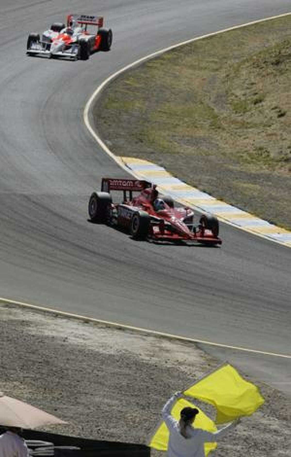 AP Dario Franchitti, of Scotland, leads Ryan Briscoe, of Australia, under a yellow flag during the IndyCar Series' Indy Grand Prix of Sonoma auto race Sunday at Infineon Raceway in Sonoma, Calif.