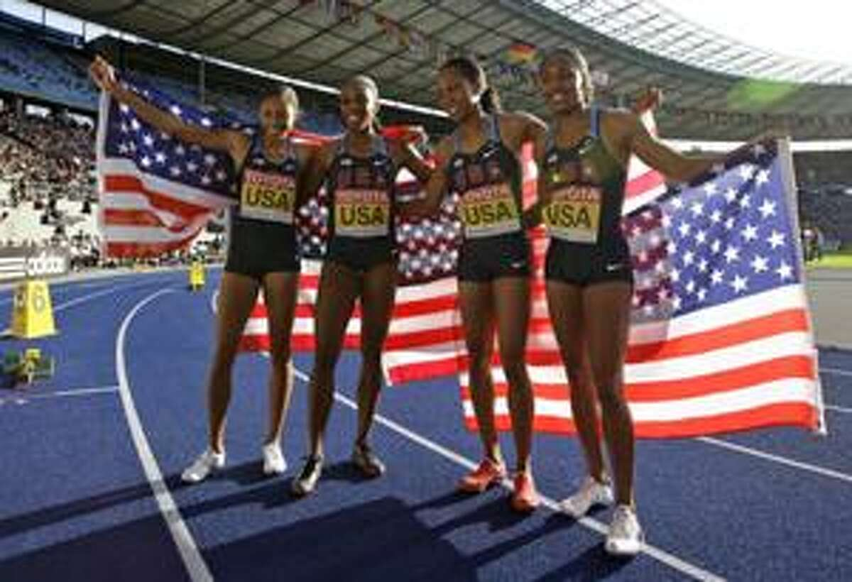 AP Allyson Felix, Lashinda Demus, Sanya Richards and Debbie Dunn of the United States, from left, celebrate after winning the gold medal in the final of the women's 4x400-meter relay during the World Athletics Championships in Berlin, Sunday.