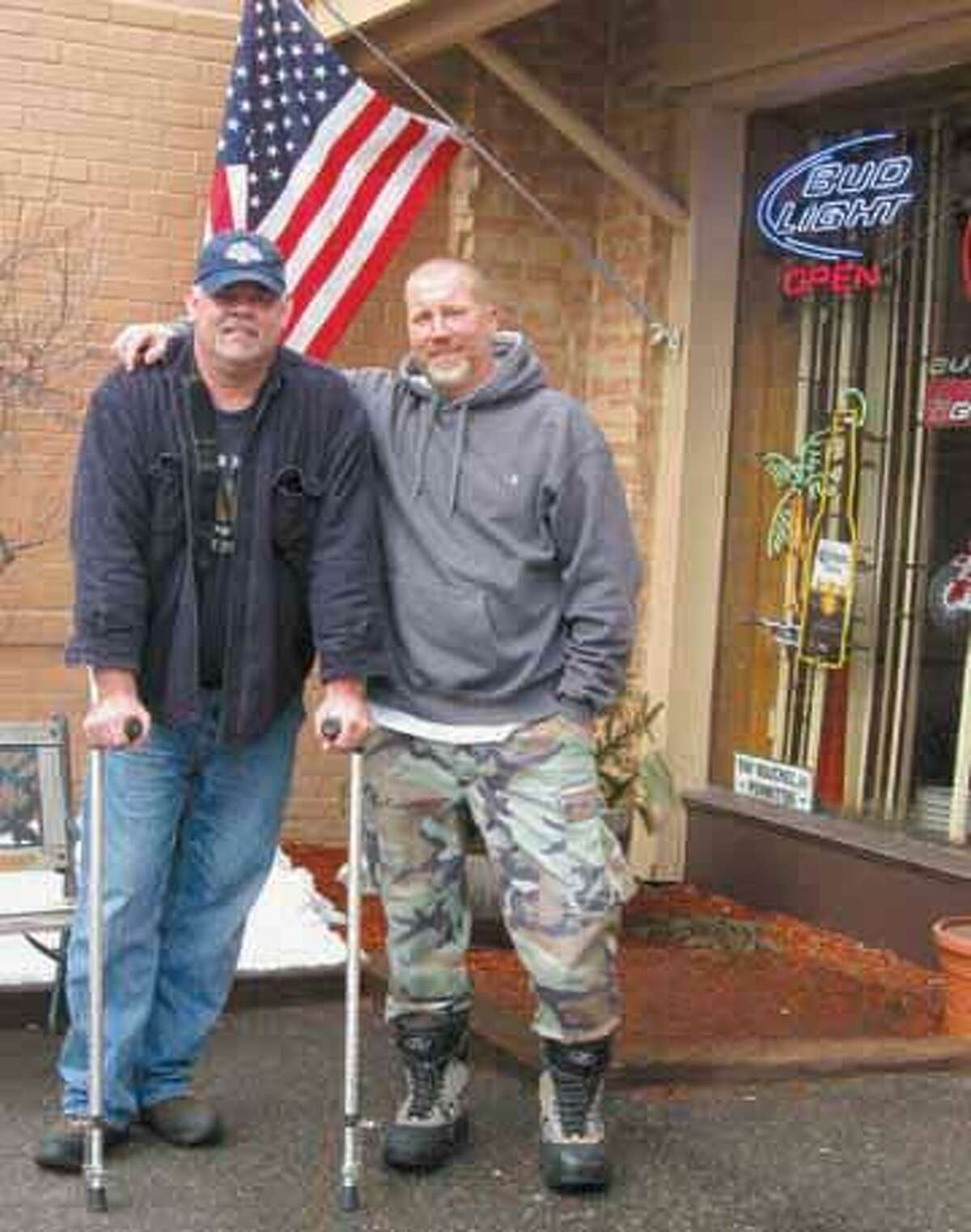 Lifelong friends Dwayne Paige and Ray Bouchez, owner of Billy Ray's Café in Winsted, pose outside Bouchez's establishment. They will host