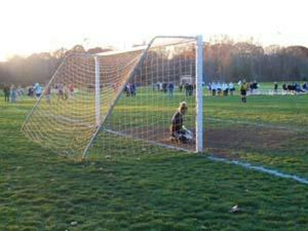 KEVIN D. ROBERTS/Register Citizen Lewis Mills goalkeeper Lindsey Brown stops a penalty kick from Nonnewaug's Sidney Spremullo during the second half of Wednesday's Berkshire League girls soccer game in Woodbury.