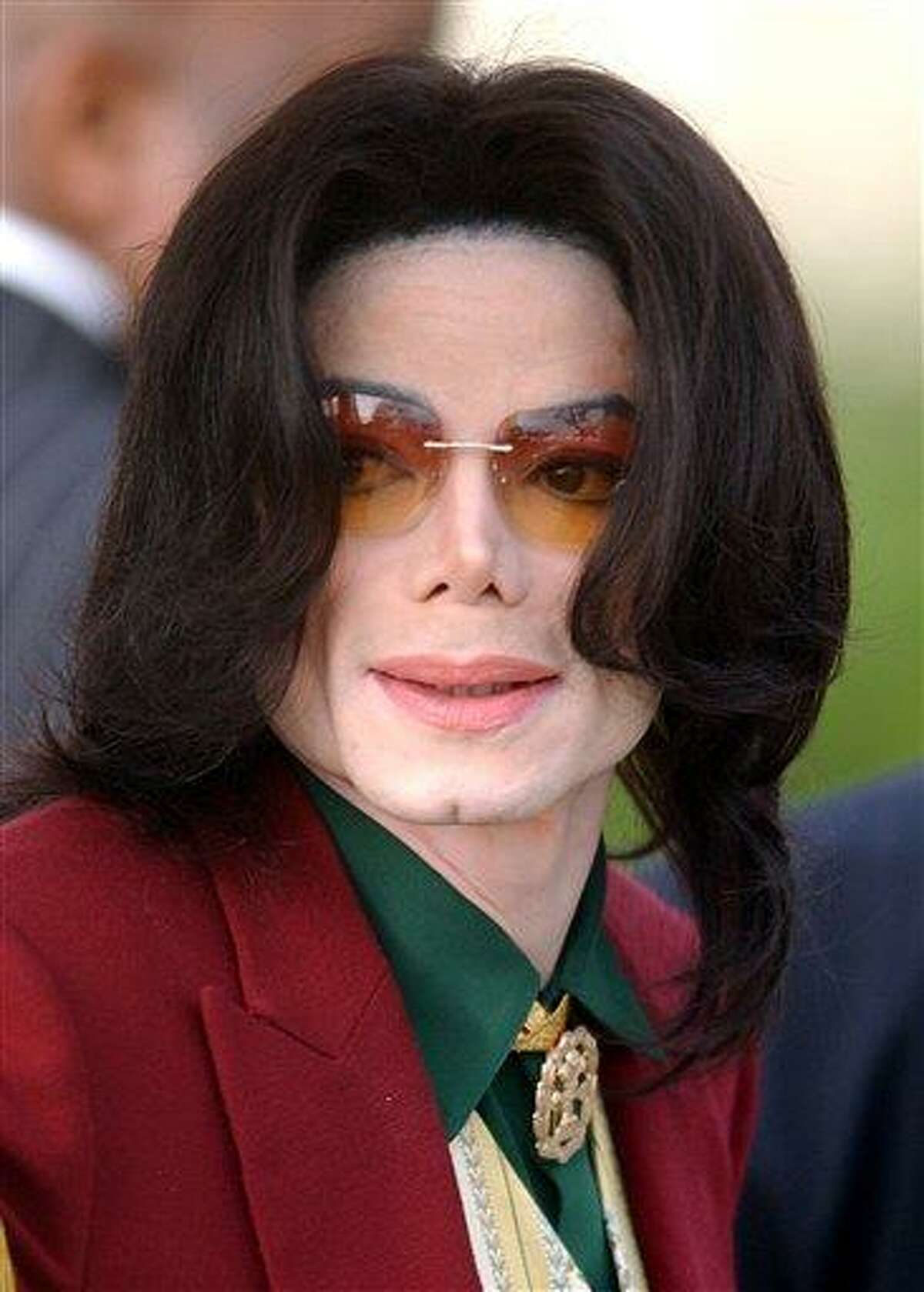 FILE - In this March 17, 2005 file photo, pop star Michael Jackson arrives at the Santa Barbara County Courthouse in Santa Maria, Calif. (AP Photo/Michael A. Mariant, file)