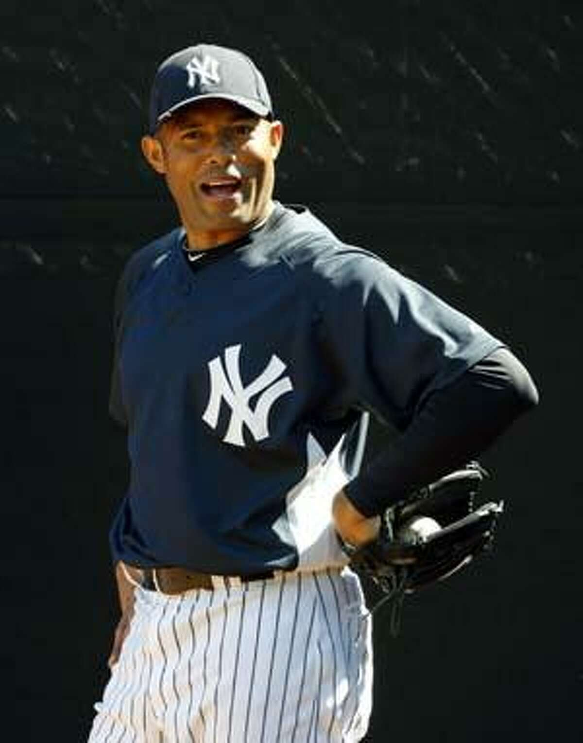 New York Yankees closer Mariano Rivera talks back to catcher Francisco Cervelli, not seen, during a bullpen session at baseball spring training at Steinbrenner Field in Tampa, Fla., Monday, March 1, 2010. (AP Photo/Kathy Willens)
