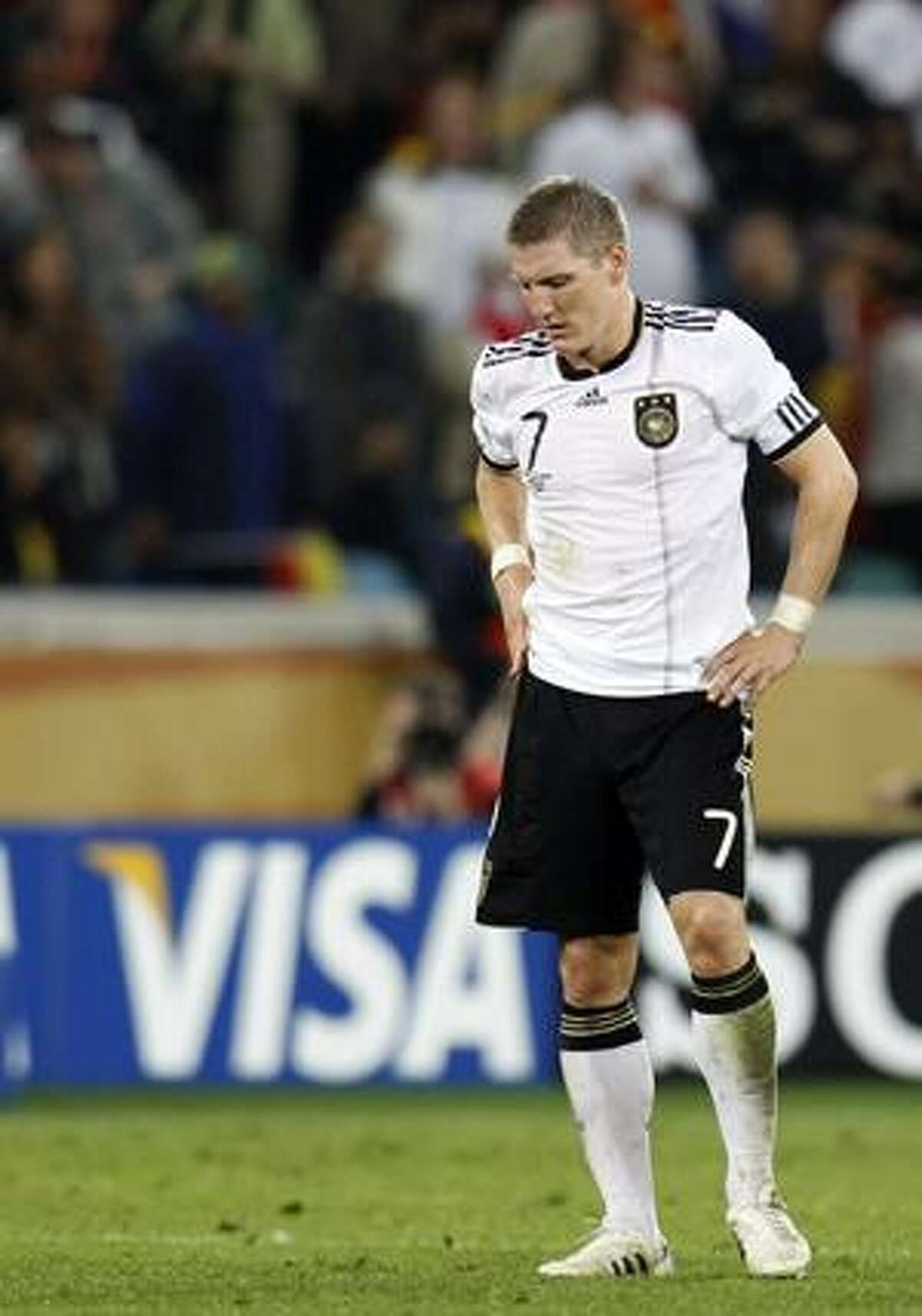 Germany's Bastian Schweinsteiger reacts after the World Cup semifinal soccer match between Germany and Spain at the stadium in Durban, South Africa, Wednesday. Germany lost 1-0. (AP Photo/DLuca Bruno)
