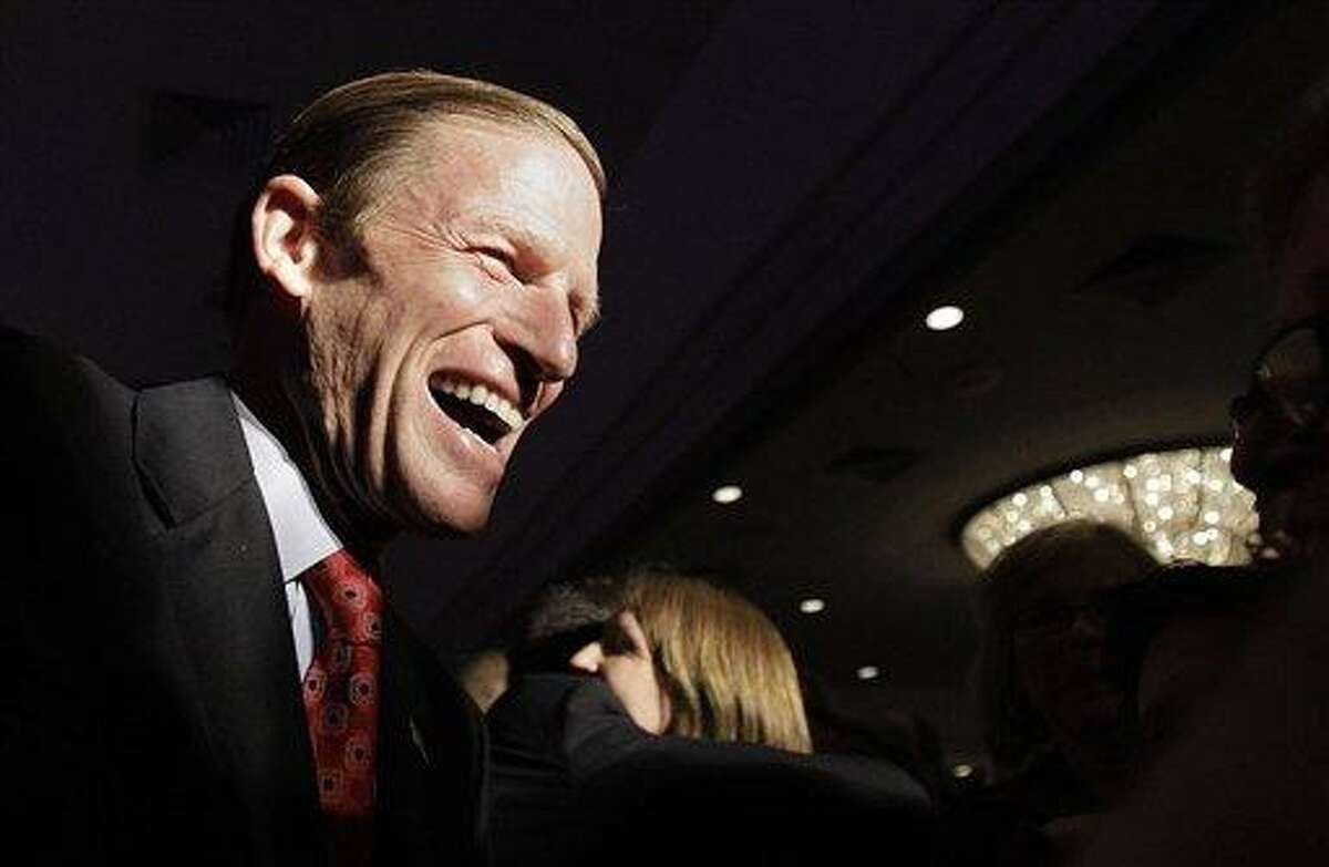 Connecticut Attorney General and newly elected Sen. Richard Blumenthal, D-Conn., greets supporters at the conclusion of his election night rally in Hartford, Tuesday, Nov. 2, 2010. (AP Photo/Stephan Savoia)
