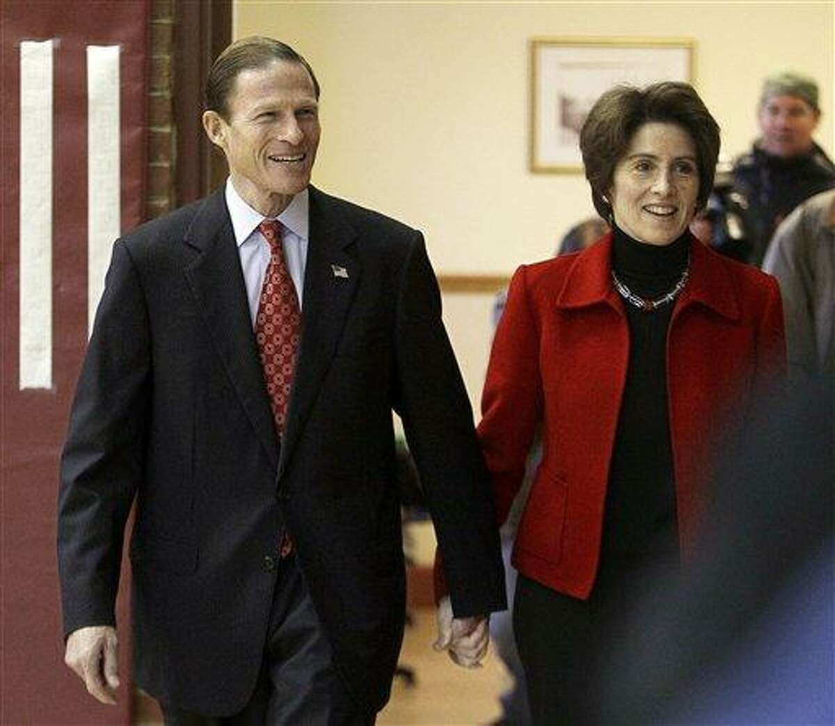 Connecticut Attorney General and Democratic candidate for the Senate Richard Blumenthal and his wife Cynthia walk hand-in-hand into the Bendheim Western Greenwich Civic Center before voting in Greenwich, Conn., Tuesday morning, Nov. 2, 2010. (AP Photo/Stephan Savoia)