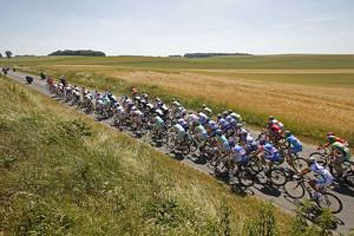 AP The pack rides through a field in northern France during the fourth stage of the Tour de France cycling race over 153.5 kilometers (95.4 miles) with start in Cambrai and finish in Reims, Wednesday.