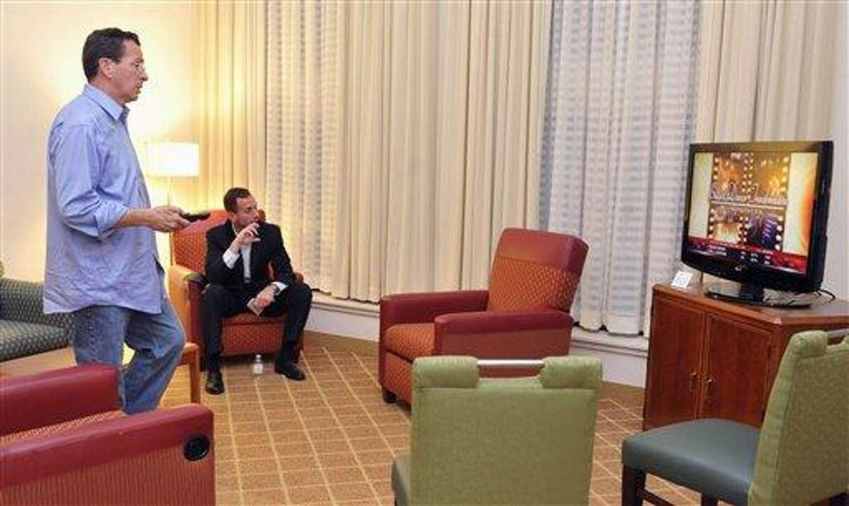 Democratic candidate for governor Dan Malloy, left, watches election results in his hotel room with campaign senior advisor Roy Occhiogrosso in Hartford, Conn., Tuesday, Nov. 2, 2010. (AP Photo/Jessica Hill)