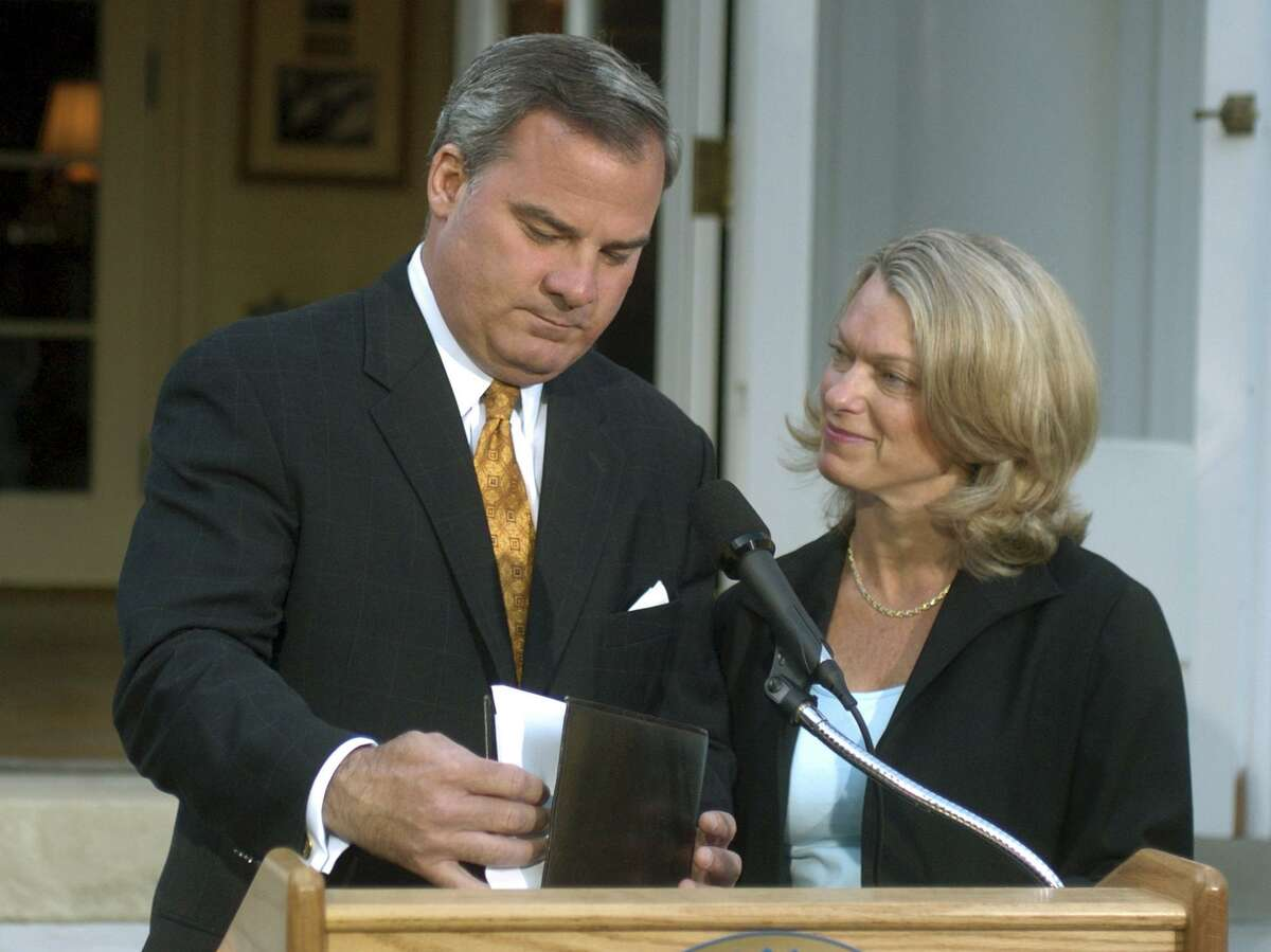 In this June 21, 2004 file photo, Connecticut Gov. John G. Rowland, with his wife Patty beside him, finishes his speech after he announced his resignation from office at the Governor's Residence in Hartford. Rowland resigned during an impeachment probe and spent 10 months in federal prison after pleading guilty to a corruption-related charge. (AP Photo/Bob Child, Pool, File)