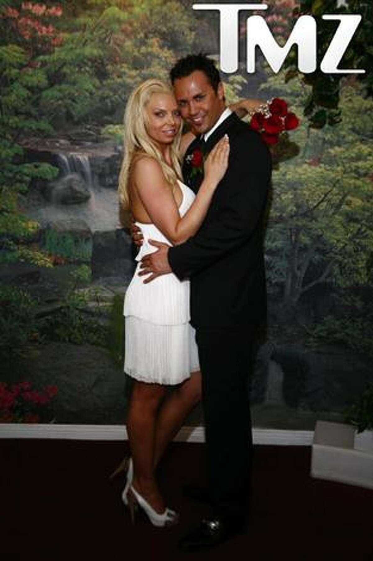 This photo provided by TMZ, shows Ryan Alexander Jenkins and Jasmine Fiore's March 18, 2009 wedding in Las Vegas. Jenkins, a reality TV contestant, is charged with killing his wife, a former swimsuit model. (AP Photo/TMZ) ** NO SALES **