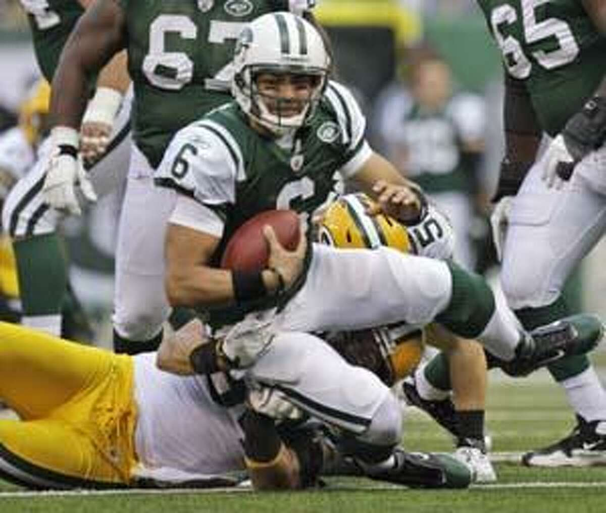 New York Jets quarterback Mark Sanchez (6) is sacked by Green Bay Packers linebacker Brandon Chillar (54) during the first quarter of an NFL football game at New Meadowlands Stadium on Sunday, Oct. 31, 2010, in East Rutherford, N.J. (AP Photo/Kathy Willens)