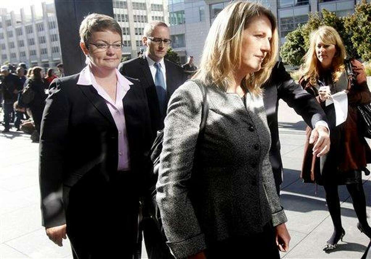 Kris Perry, left, and Sandy Stier walk into a federal courthouse before closing arguments in the United States District Court proceedings challenging Proposition 8 in San Francisco, Wednesday, June 16, 2010. Perry and Stier are one of the two same-sex couple plaintiffs in a federal court case on California's same-sex marriage ban. (AP Photo/Jeff Chiu)
