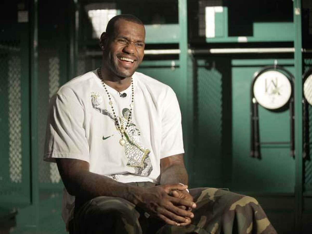 Cleveland Cavaliers star LeBron James sits for an interview in the locker room of his former high school, Akron St. Vincent-St. Mary in Akron, Ohio on Friday, Aug. 21, 2009. LeBron was on hand to promote the documentary film