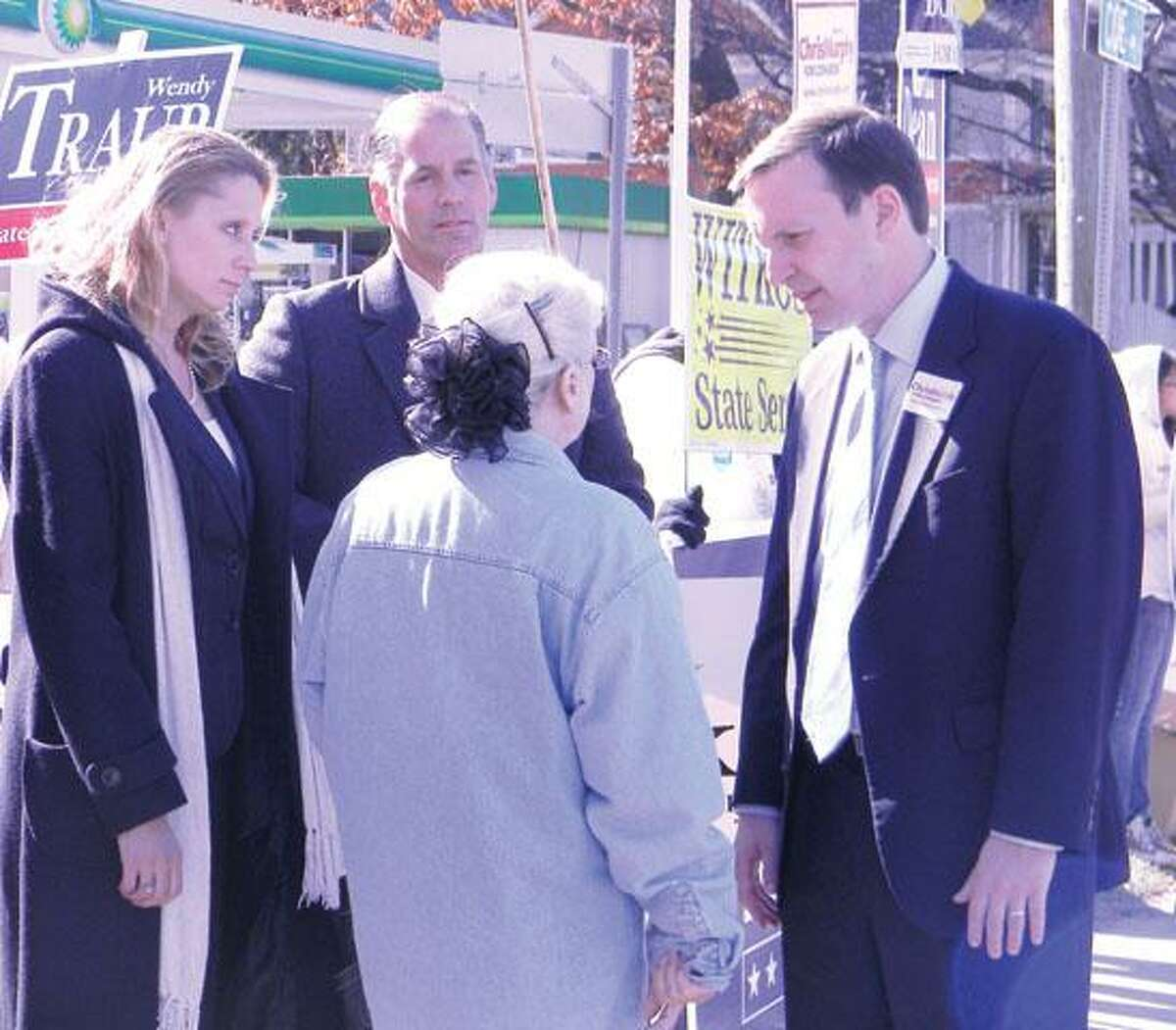 MIKE AGOGLIATI/ register CitizenIncumbent state Rep. Michelle Cook, D-65, left, meets with Congressman Chris Murphy, D-5, right and supporters outside of the Torrington Armory Tuesday morning.