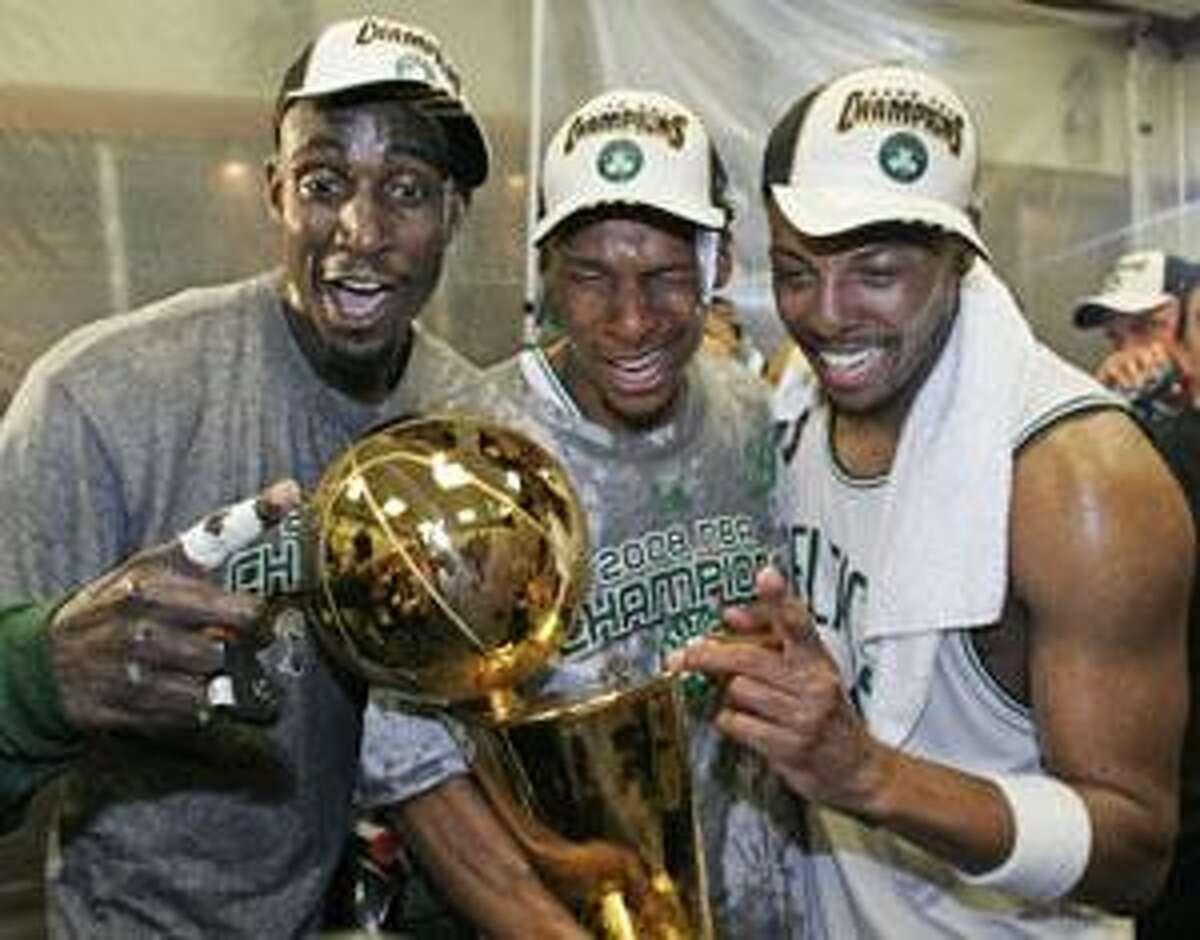 AP In this June 17, 2008, file photo, Boston Celtics' Kevin Garnett, left, Ray Allen, center, and Paul Pierce celebrate in the locker room after winning the NBA championship with a 131-92 Game 6 win over the Los Angeles Lakers in Boston.