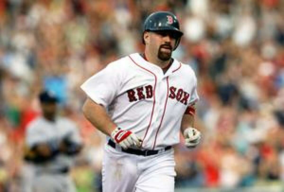 Boston Red Sox' Kevin Youkilis rounds the bases after his two-run homer during the sixth inning against the New York Yankees at Fenway Park in Boston Saturday.