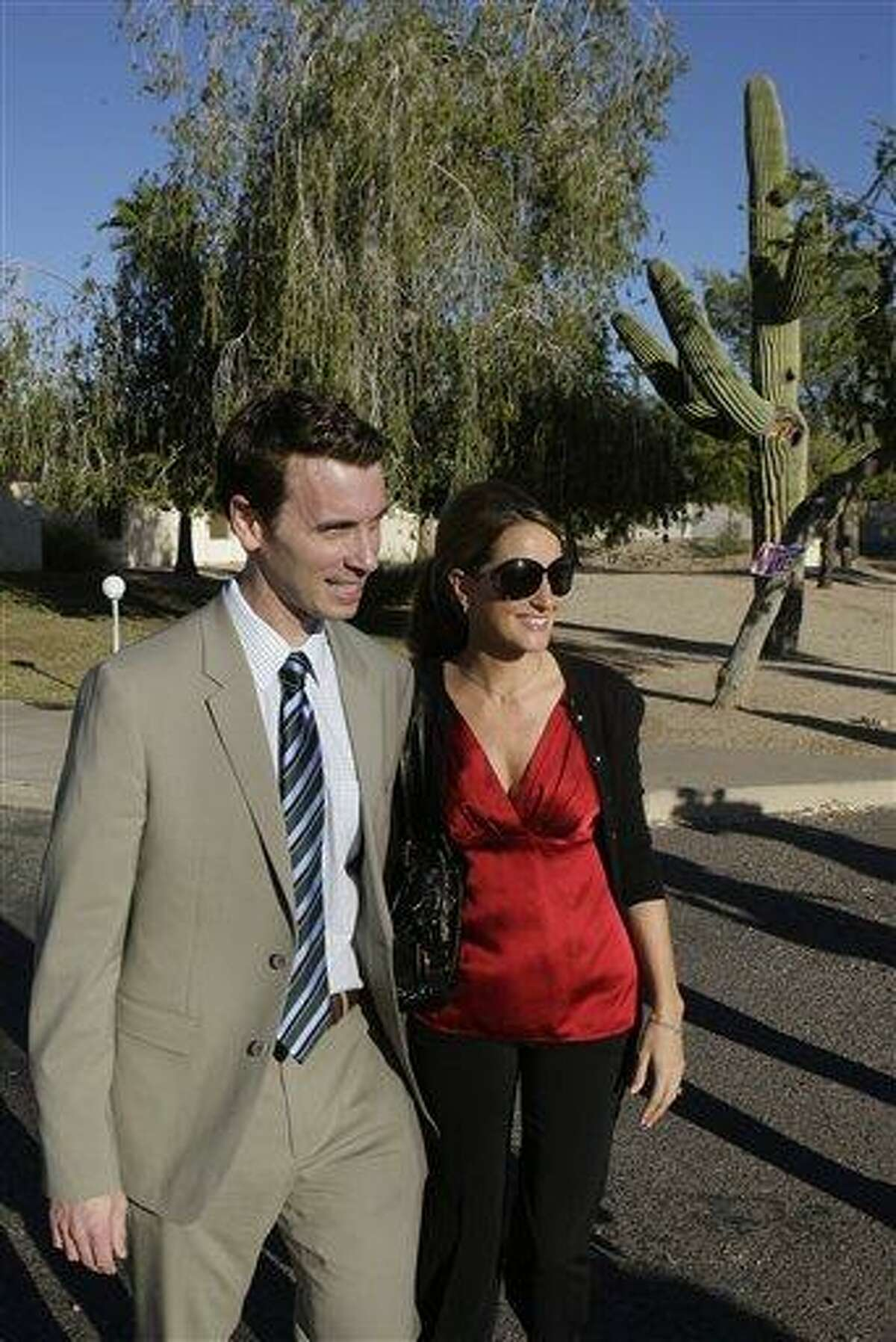 Republican congressional candidate for the 3rd District Ben Quayle, left, leaves his polling station after voting with his wife Tiffany Quayle on election day Tuesday, Nov. 2, 2010, in Phoenix. (AP Photo/Ross D. Franklin)