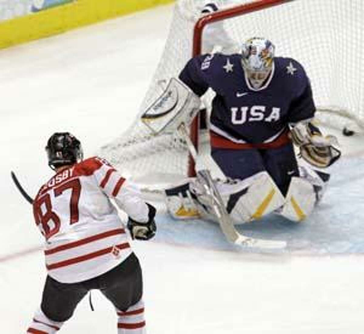 AP Canada's Sidney Crosby (87) shoots past U.S.A. goalie Ryan Miller (39) for the game-winning goal in overtime of the men's gold medal ice hockey game at the Vancouver 2010 Olympics in Vancouver, British Columbia, Sunday.