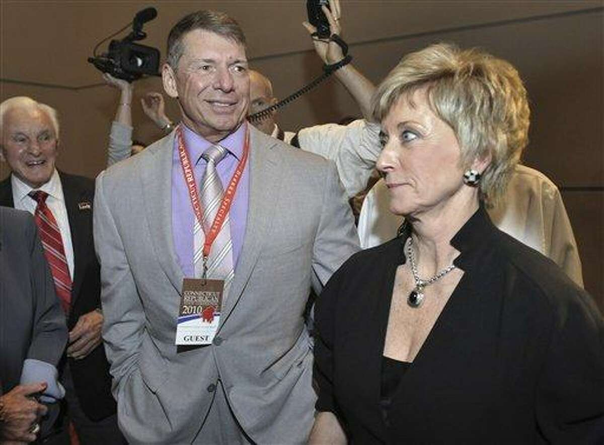 FILE - In this May 21, 2010 file photo, Republican candidate for U.S. Senate Linda McMahon, right, and husband Vince McMahon, left, wait for delegate votes to be tallied during the Connecticut Republican Convention in Hartford, Conn. Vince McMahon has largely avoided the role of political spouse, and his World Wrestling Entertainment alter ego has taken a TV hiatus, while his wife Linda campaigned for the Nov. 2, 2010 election. But just days before the election, he has emerged to defend a business empire he says has been trashed because of politics. (AP Photo/Jessica Hill, File)