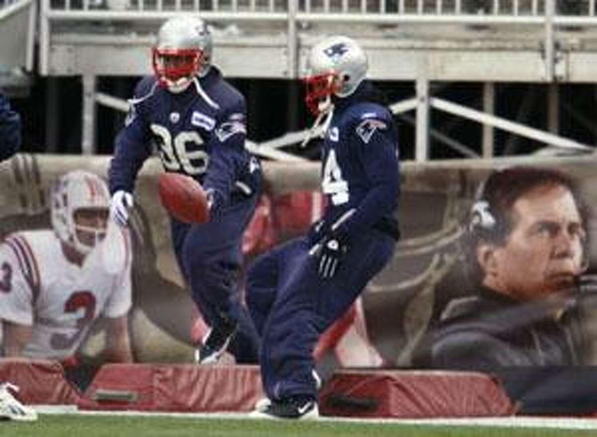 AP New England Patriots safety James Sanders, left, and teammate cornerback Jonathan Wilhite, right, perform drills during practice at Gillette Stadium, in Foxboro, Mass., on Dec. 23. The Patriots face the Jacksonville Jaguars today in Foxboro.