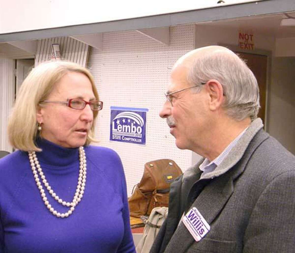 MIKE AGOGLIATI/ Register CitizenState Rep. Roberta Willis, D-64 talks with her husband, Bill, while the two wait for election results to filter in. Willis won re-election and will serve a 6th term as state Rep.
