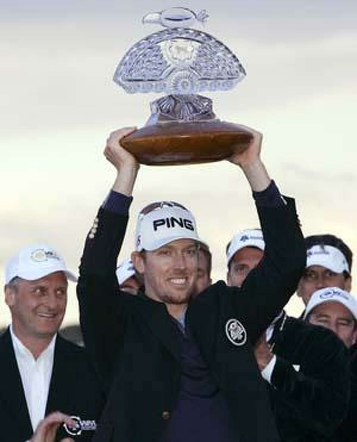 AP Phoenix Open champion Hunter Mahan holds the winner's trophy after the final round of the golf tournament Sunday in Scottsdale, Ariz. Mahan finished the tournament at 16-under par, one stroke ahead of Rickie Fowler.