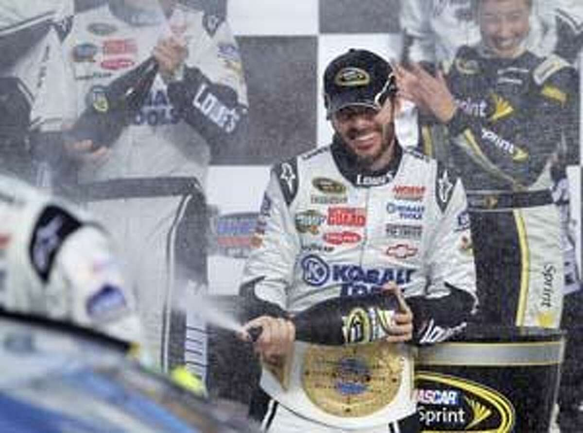 AP Jimmie Johnson celebrates in victory lane after winning the NASCAR Sprint Cup Series auto race Sunday in Las Vegas.