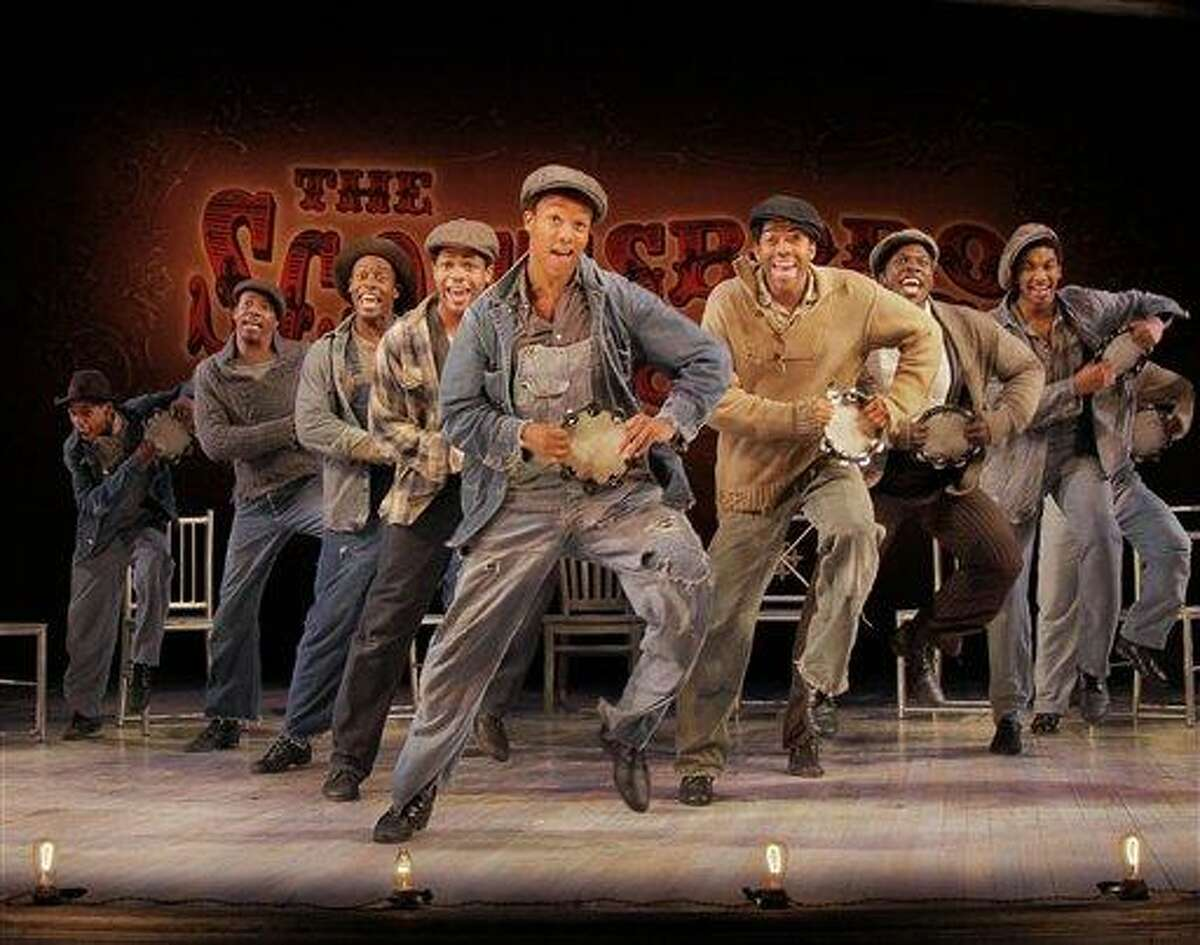 In this undated theater publicity image released by Boneau/Bryan-Brown, from left, Jeremy Gumbs, Rodney Hicks, Josh Breckenridge, Derrick Cobey, Kendrick Jones, Julius Thomas III, Joshua Henry, Christian Dante White and James T. Lane are shown in a scene from