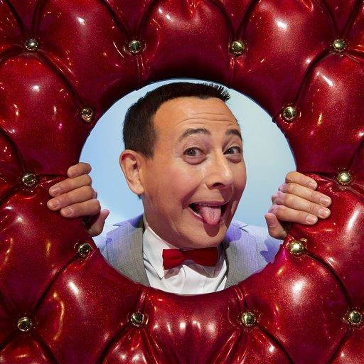 In this Friday, Oct. 29, 2010 photo, Paul Reubens, in character as Pee-wee Herman, poses on stage after a performance of