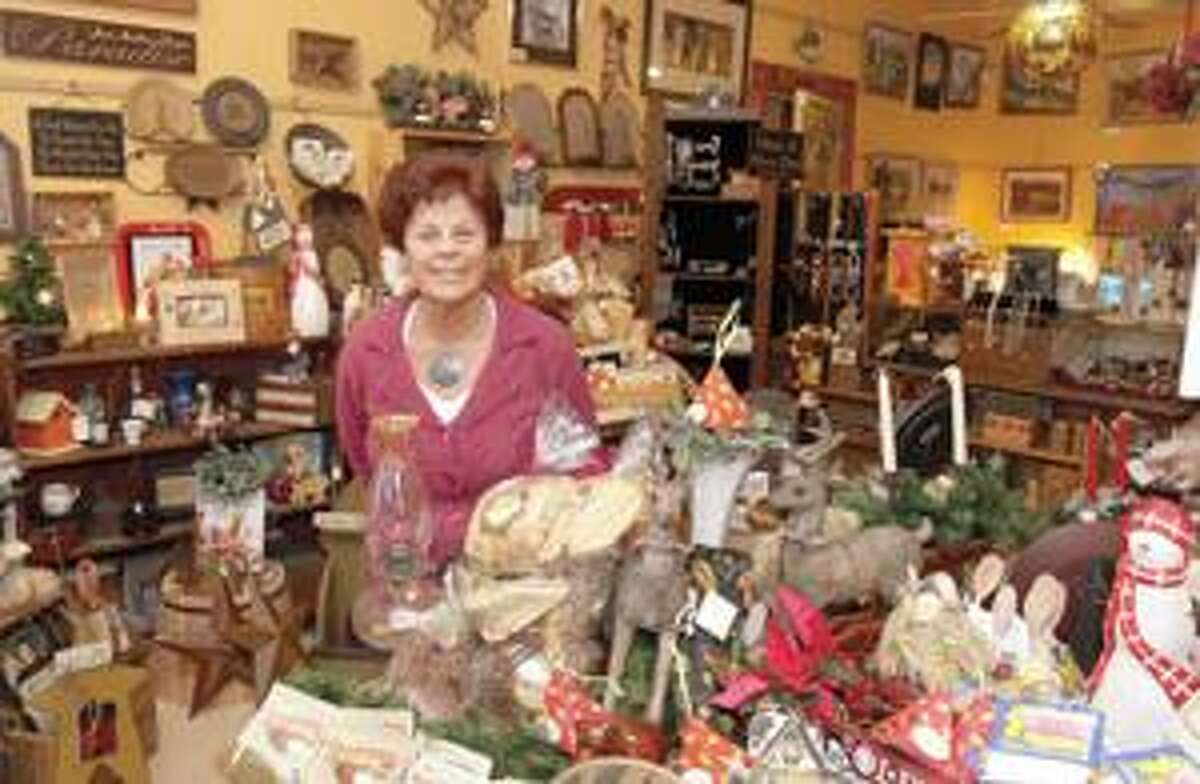 SONJA ZINKE/Register CitizenCorinne Markwald Johnson owner of the Peddlers' Junction located at 510 Main Street in New Hartford. Purchase a glossy print of this photo and more at www.registercitizen.com