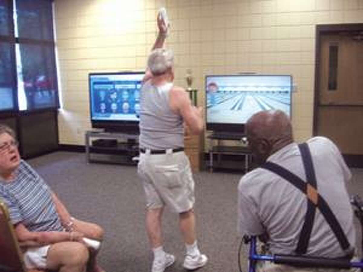 JESSIE SAWYER/Register Citizen/ Mark Portinari stayed out of the head by playing Wii Bowling on Wednesday with other seniors at the Edward E. Sullivan Senior Center in Torrington.
